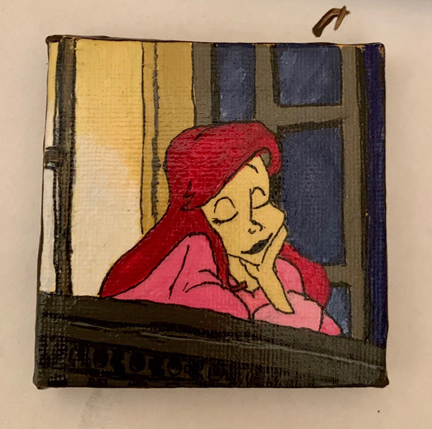 A hand painted cartoon character slumped on a windowsill