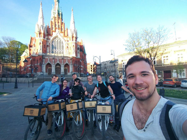 AcroRock Dance School members riding bicycles in Krakow, Poland